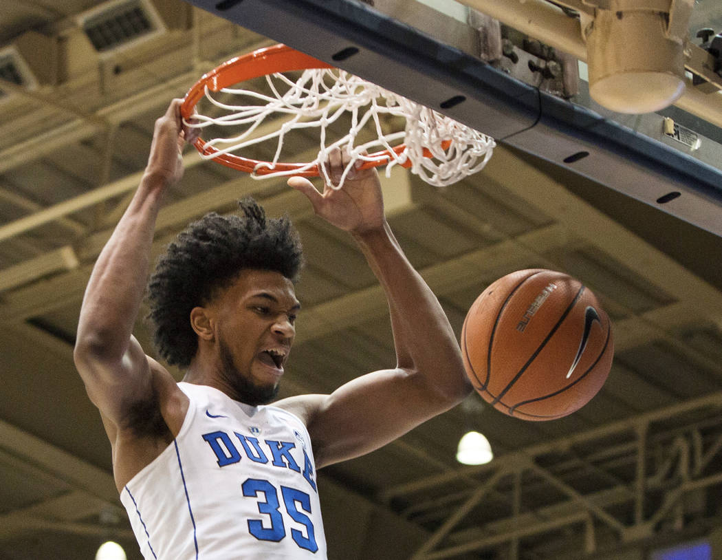 FILE - In this Jan. 27, 2018, file photo, Duke's Marvin Bagley III (35) dunks the ball during the first half of an NCAA college basketball game against Virginia in Durham, N.C. Marvin Bagley III d ...