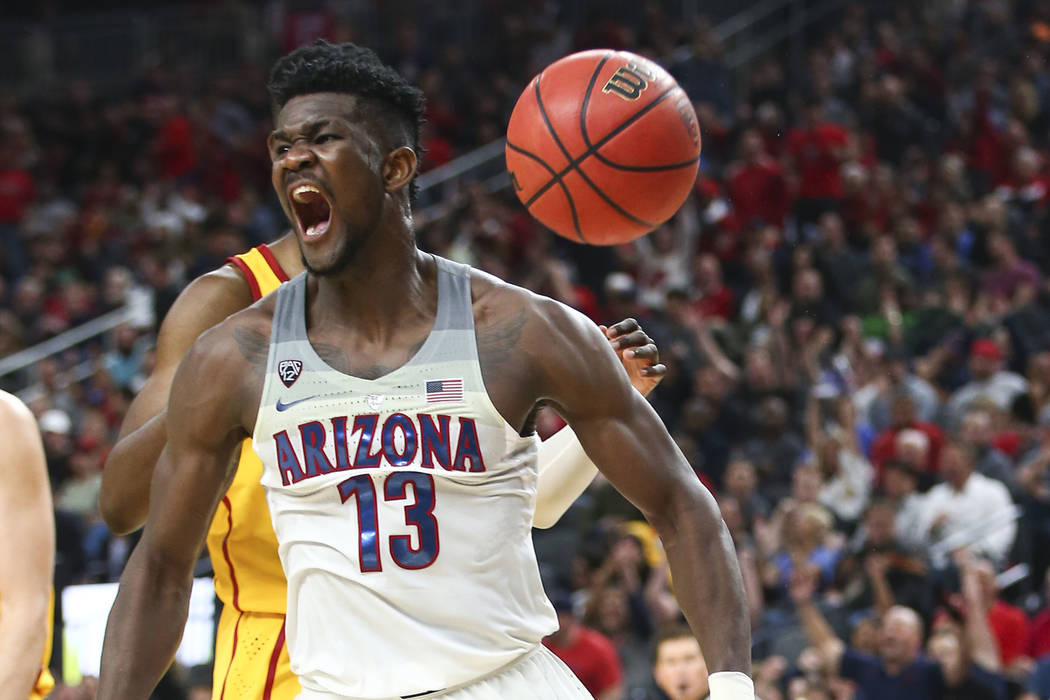 Arizona Wildcats forward Deandre Ayton (13) celebrates his dunk over the USC Trojans during the Pac-12 tournament championship basketball game at T-Mobile Arena in Las Vegas on Saturday, March 10, ...