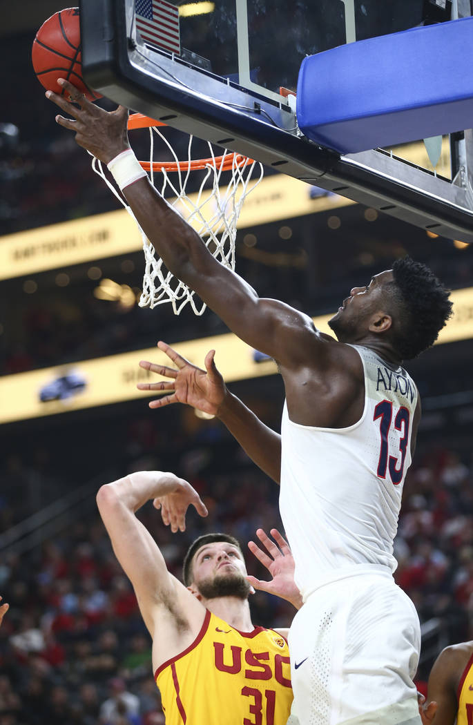 Arizona Wildcats forward Deandre Ayton (13) goes to the basket against USC Trojans forward Nick Rakocevic (31) during the Pac-12 tournament championship basketball game at T-Mobile Arena in Las Ve ...