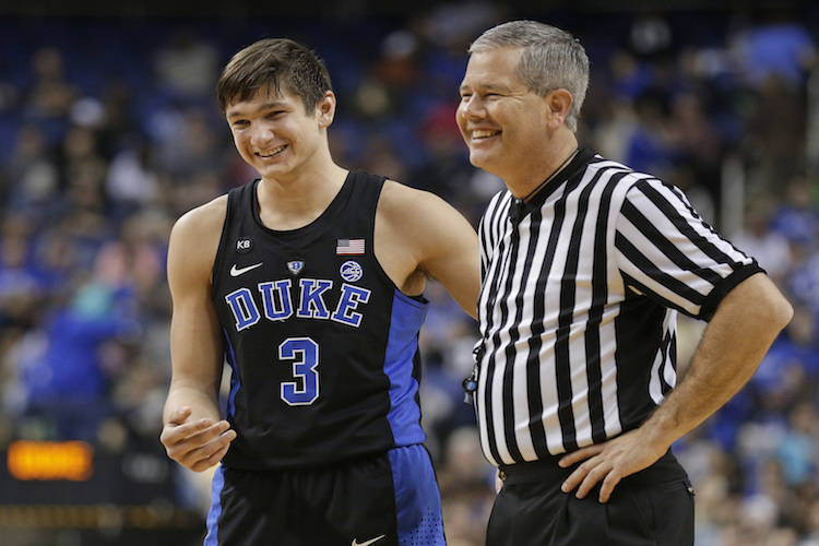 Duke's Grayson Allen (3) shares a laugh with an official in the second half of an NCAA college basketball game against Elon in Greensboro, N.C., Wednesday, Dec. 21, 2016. Duke won 72-61. (Chuck Bu ...