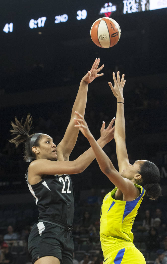 Aces center A'ja Wilson (22) shoots a jump shot over Dallas Wings forward Azurá Stevens (30) in the 2nd quarter on Wednesday, June 27, 2018, at the Mandalay Bay Events Center, in Las Vegas. B ...