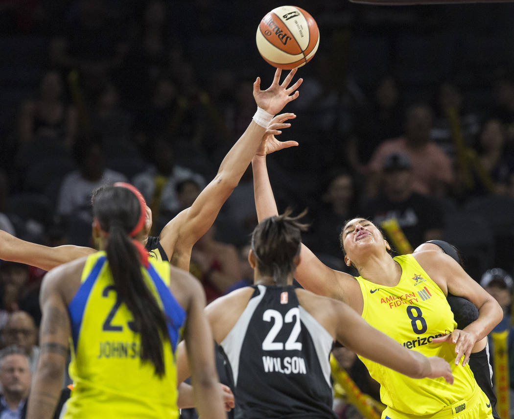 Dallas Wings center Liz Cambage (8) fights for a rebound with Aces center A'ja Wilson (22) in the 3rd quarter on Wednesday, June 27, 2018, at the Mandalay Bay Events Center, in Las Vegas. Benjamin ...
