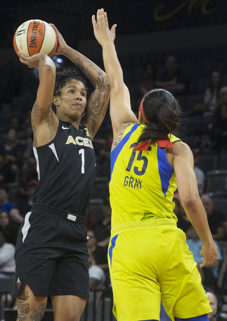 Aces forward Tamera Young (1) shoots over Dallas Wings guard Allisha Gray (15) in the 1st quarter on Wednesday, June 27, 2018, at the Mandalay Bay Events Center, in Las Vegas. Benjamin Hager Las V ...