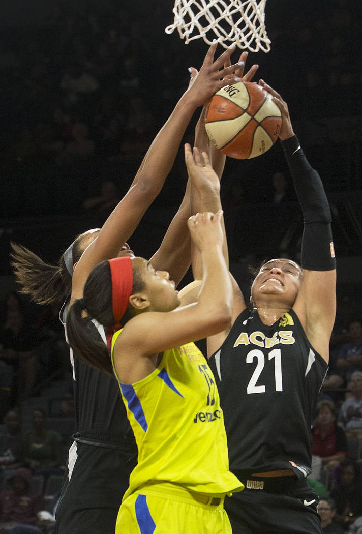 Aces guard Kayla McBride (21)fights for a rebound with Dallas Wings guard Allisha Gray (15) in the 1st quarter on Wednesday, June 27, 2018, at the Mandalay Bay Events Center, in Las Vegas. Benjami ...