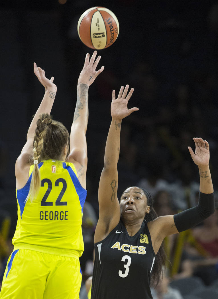 Aces center Kelsey Bone (3) reaches out to block the shot of Dallas Wings center Cayla George (22) in the 3rd quarter on Wednesday, June 27, 2018, at the Mandalay Bay Events Center, in Las Vegas. ...