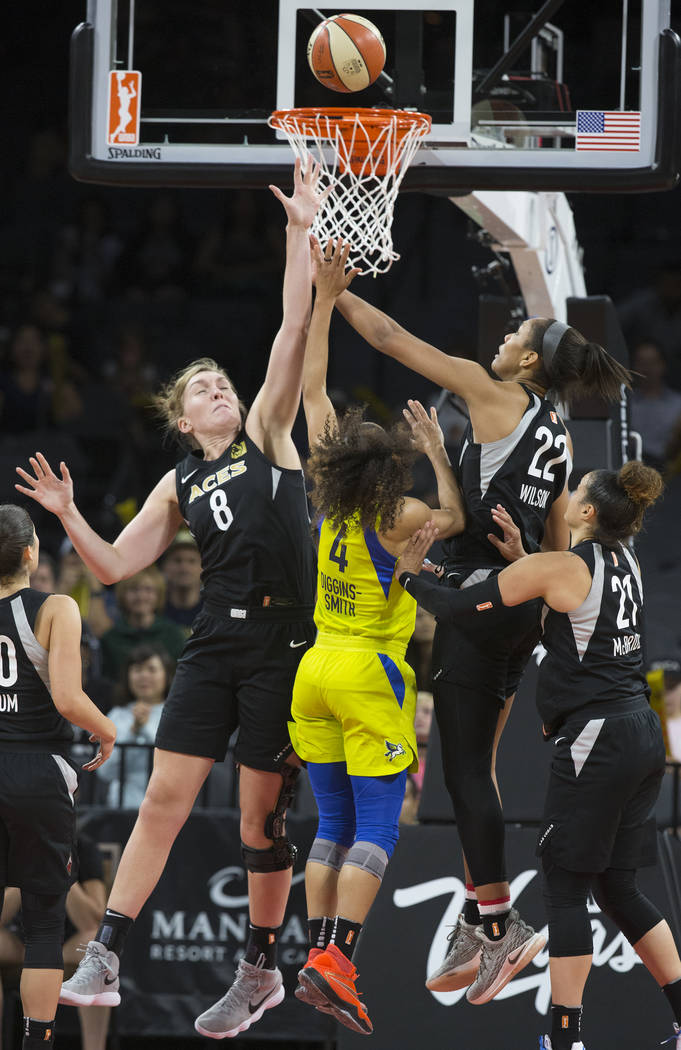 Aces center Carolyn Swords (8) and A'ja Wilson (22) leap to block the shot of Dallas Wings guard Skylar Diggins-Smith (4) on Wednesday, June 27, 2018, at the Mandalay Bay Events Center, in Las Veg ...