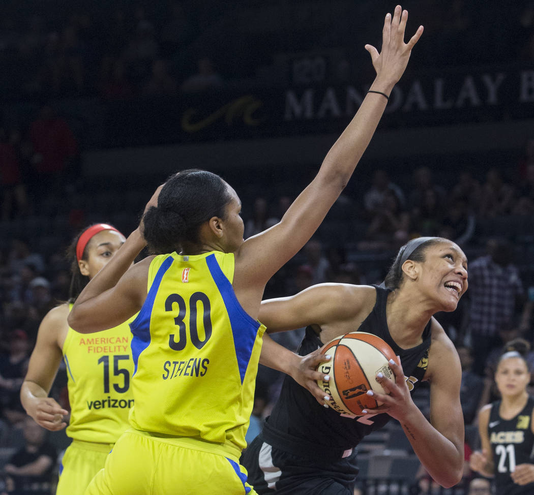 Aces center A'ja Wilson (22) drives past Dallas Wings forward Azurá Stevens (30) in the 2nd quarter on Wednesday, June 27, 2018, at the Mandalay Bay Events Center, in Las Vegas. Benjamin Hage ...