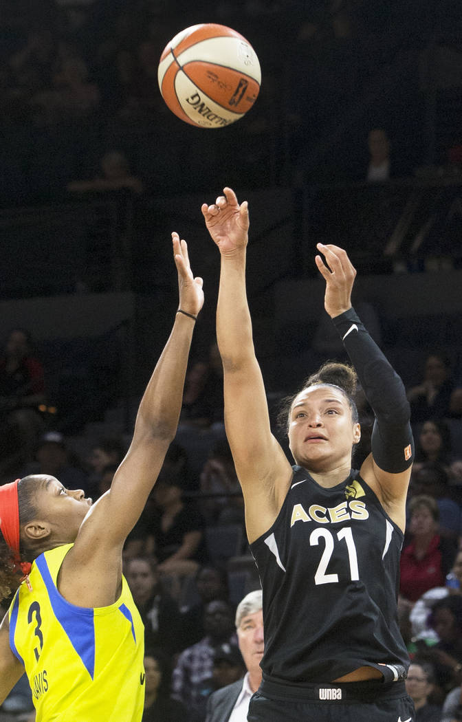 Aces guard Kayla McBride (21) shoots a jump shot over Dallas Wings forward Kaela Davis (3) in the 2nd quarter on Wednesday, June 27, 2018, at the Mandalay Bay Events Center, in Las Vegas. Benjamin ...