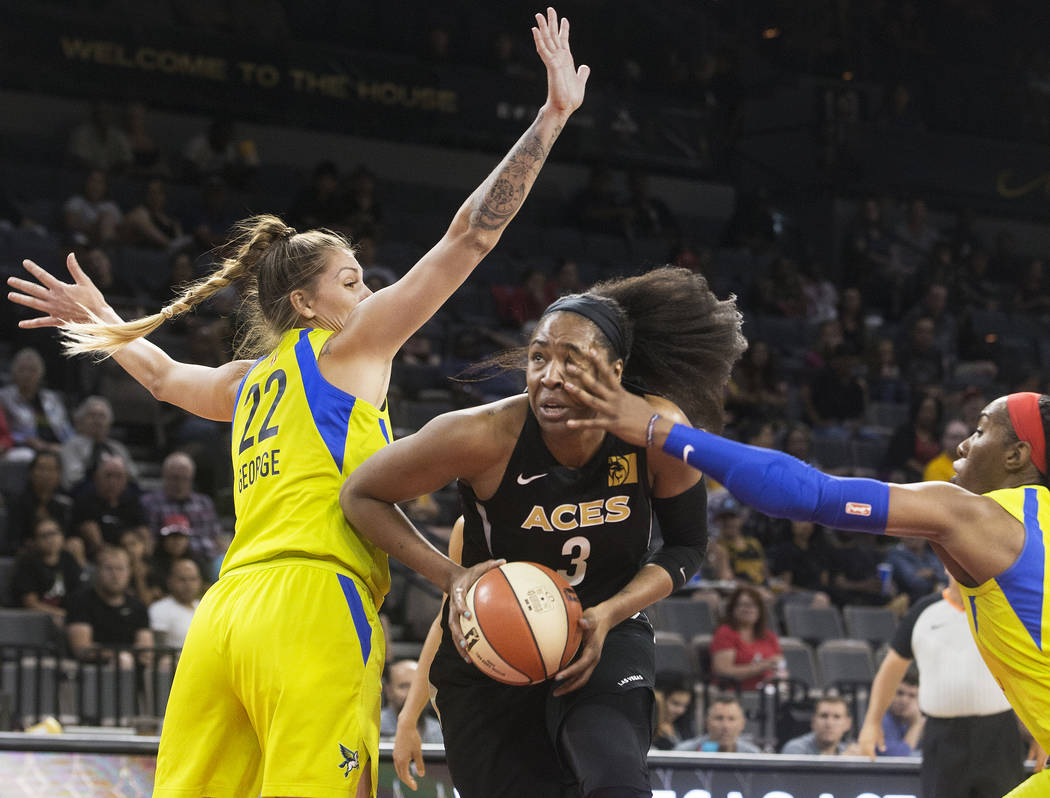 Aces center Kelsey Bone (3) gets fouled by Dallas Wings forward Kaela Davis (3) on the way to the basket past center Cayla George (22) in the 2nd quarter on Wednesday, June 27, 2018, at the Mandal ...