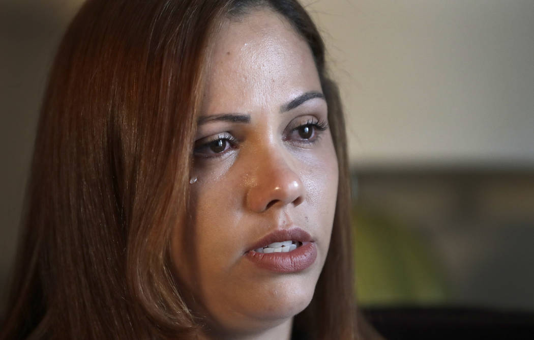 During an interview with The Associated Press Wednesday, June 27, 2018, in Evanston, Illinois, Lidia Karine Souza, who is seeking asylum from Brazil, sheds a tear as she talks about the ordeal she ...