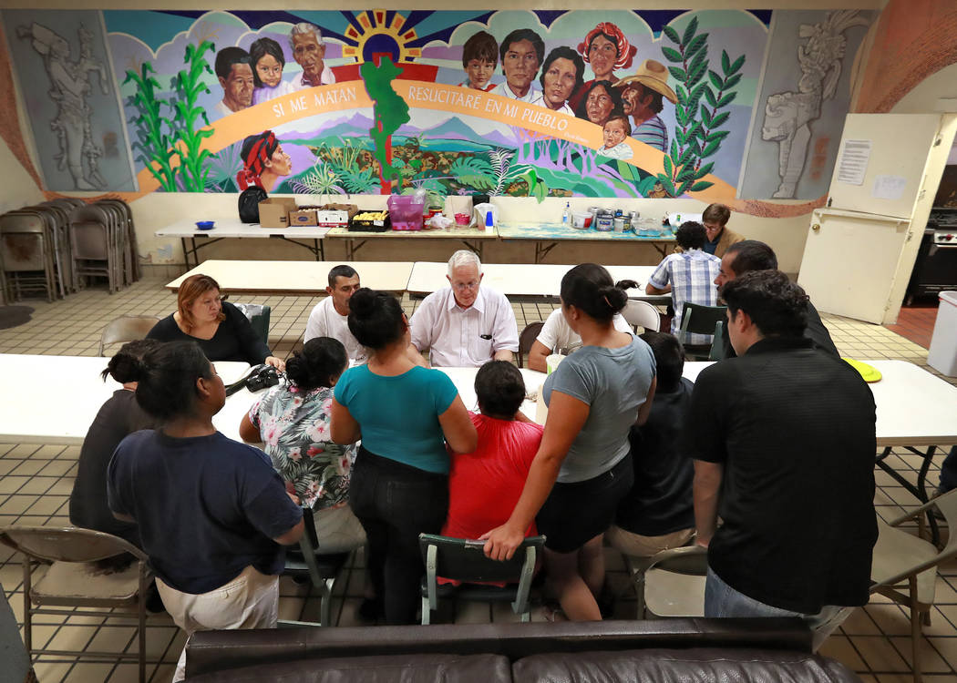 Ruben Garcia, director of the Annunciation House, speaks with migrant parents Tuesday, June 26, 2018, in El Paso, Texas. The migrants are some of the 32 parents separated from their children that ...