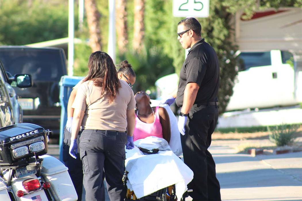 Medical personnel attend to a woman who was hurt when Las Vegas police took four robbery suspects into custody on Thursday, June 28, 2018. (Max Michor/Las Vegas Review-Journal)