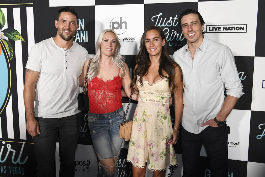 Vegas Golden Knights defenseman Deryk Engelland and his wife Melissa and goalie Marc-Andre Fleury and his wife Vronique arrive on the red carpet for Gwen Stefani's new residency at Planet Hollywoo ...