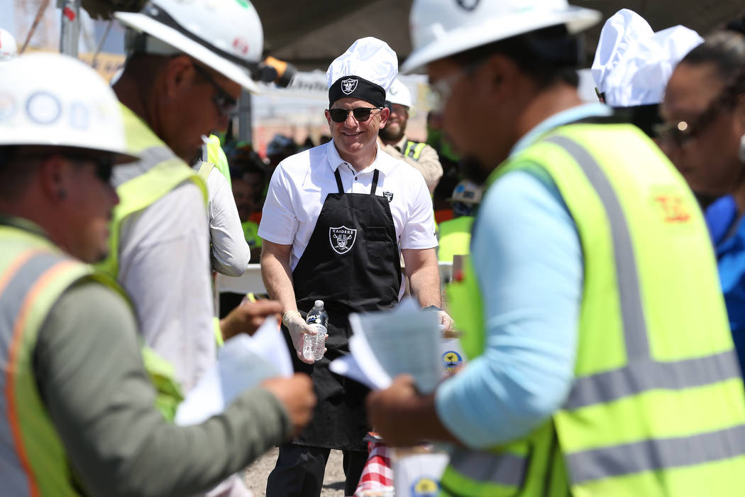 Oakland Raiders President Marc Badain hands out water during a barbecue for construction workers at the Raiders stadium site in Las Vegas, Thursday, June 28, 2018. Erik Verduzco Las Vegas Review-J ...