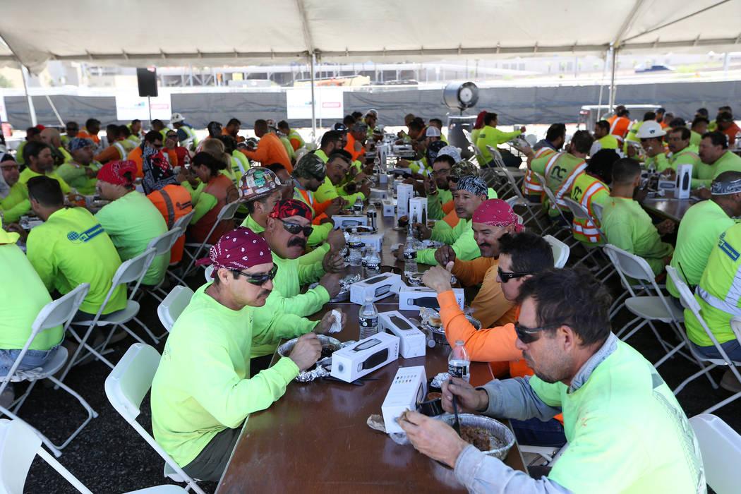 Construction workers eat lunch during a barbecue at the Raiders stadium site in Las Vegas, Thursday, June 28, 2018. Erik Verduzco Las Vegas Review-Journal @Erik_Verduzco