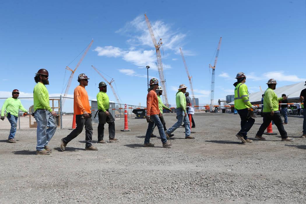 Construction workers make their way to a barbecue at the Raiders stadium site in Las Vegas, Thursday, June 28, 2018. Erik Verduzco Las Vegas Review-Journal @Erik_Verduzco