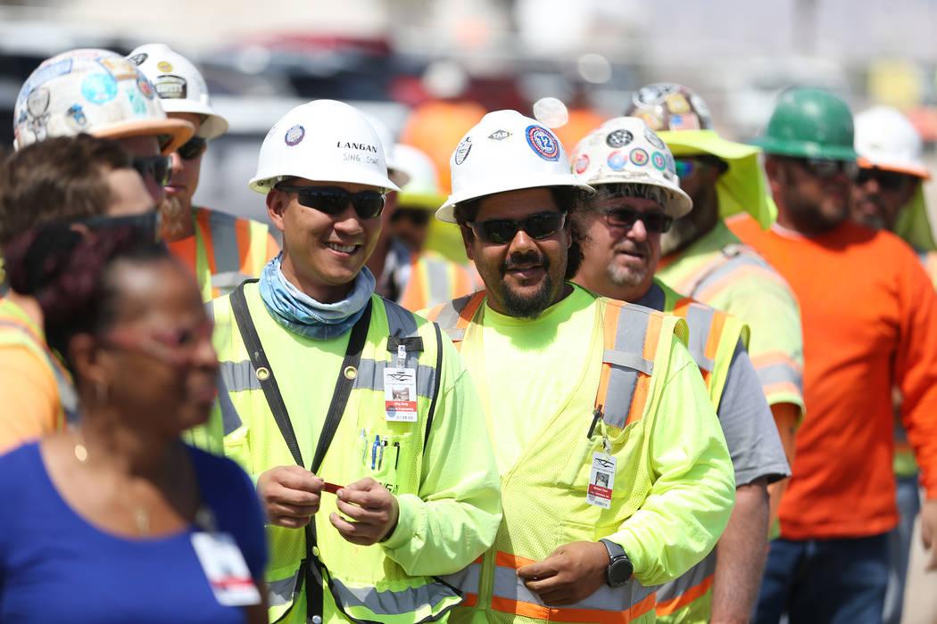 Construction workers lineup to eat during a barbecue at the Raiders stadium site in Las Vegas, Thursday, June 28, 2018. Erik Verduzco Las Vegas Review-Journal @Erik_Verduzco
