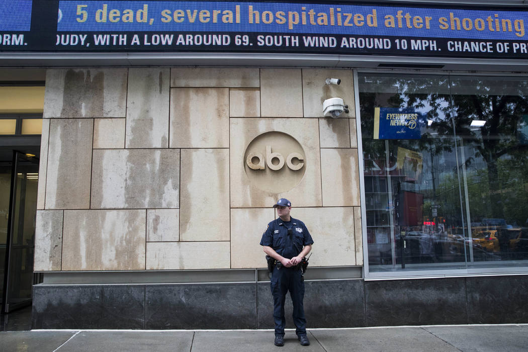 A police officer stands guard outside the ABC studio, Thursday, June 28, 2018, in New York. The New York Police Department has sent patrols to major news media organizations in response to the sho ...