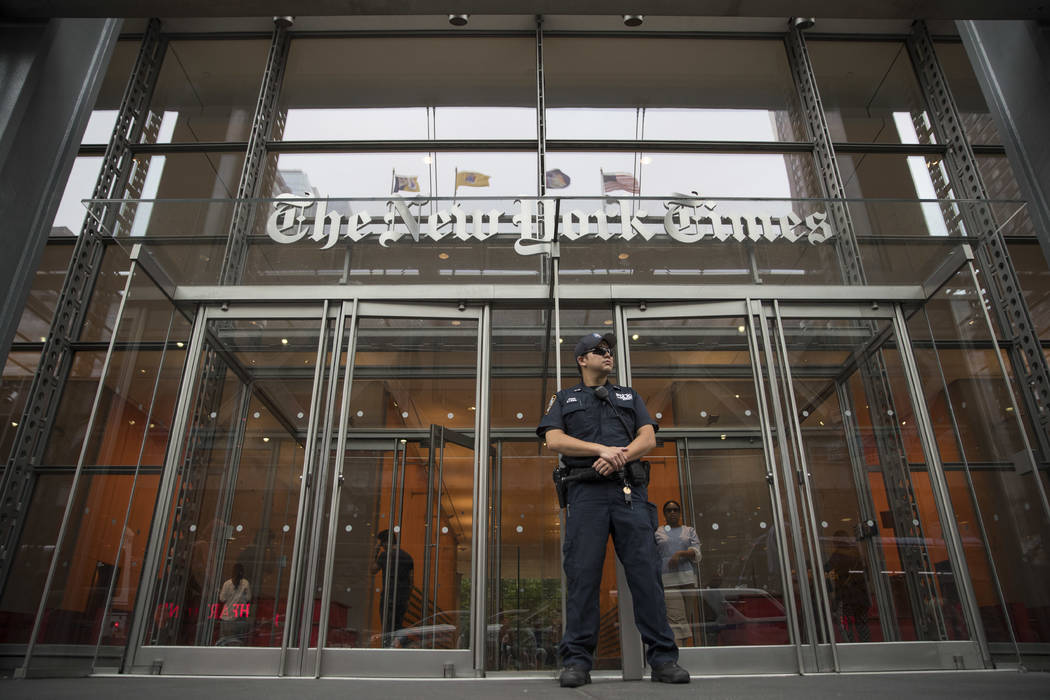 A police officer stands guard outside The New York Times building, Thursday, June 28, 2018, in New York. The New York Police Department has sent patrols to major news media organizations in respon ...