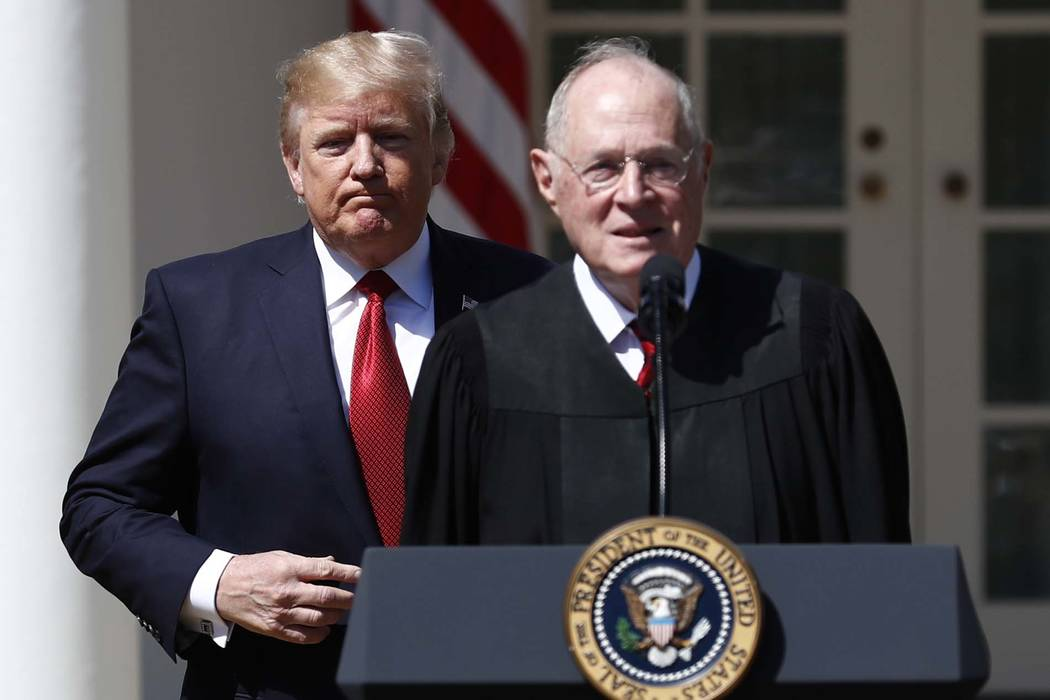 President Donald Trump, left, and Supreme Court Justice Anthony Kennedy participate in a public swearing-in ceremony for Justice Neil Gorsuch in the Rose Garden of the White House White House in W ...
