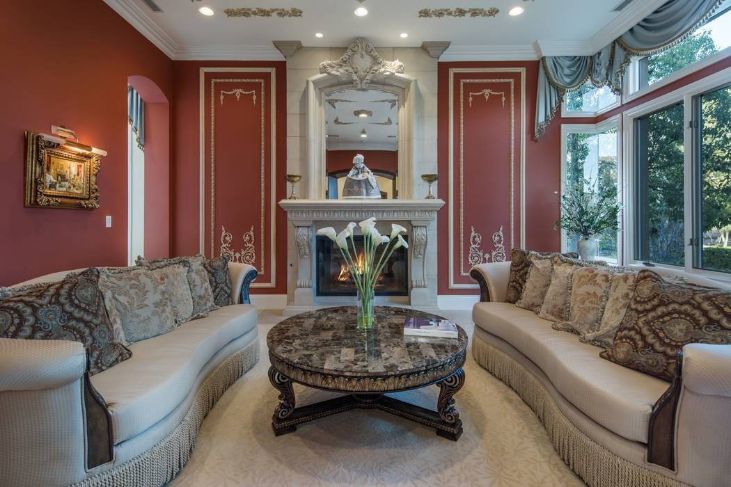 Ivan Sher Group The home has a vibrantly colored, French-inspired formal living room.