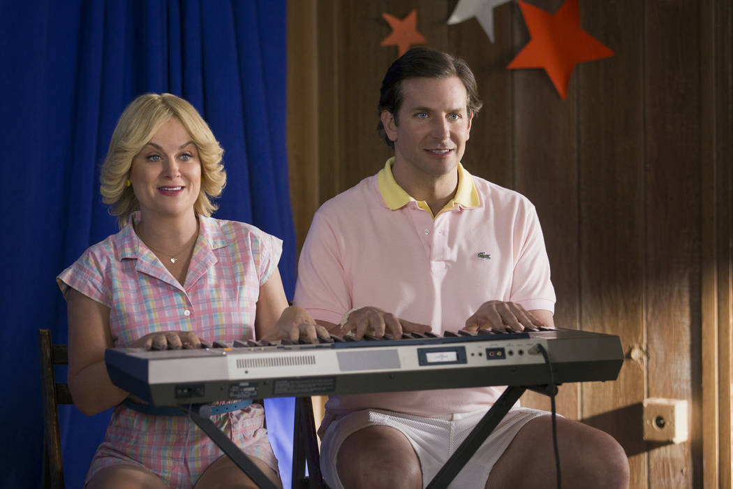 "Amy Poehler and Bradley Cooper star in ""Wet Hot American Summer: First Day of Camp."" (Netflix)"