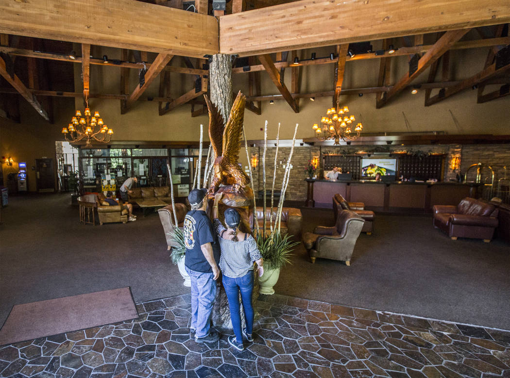 Scott and Marsha Sumpter take a look at an eagle sculpture in the lobby of The Resort on Mount Charleston on Friday, June 29, 2018, in Las Vegas. Benjamin Hager Las Vegas Review-Journal @benjaminh ...