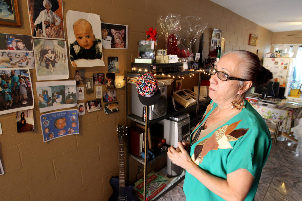 Silveria Caban, 58, looks at family photos at her Las Vegas apartment Friday, March 16, 2018. Caban said that she never saw a psychiatrist after being admitted to North Vista Hospital's psych ward ...