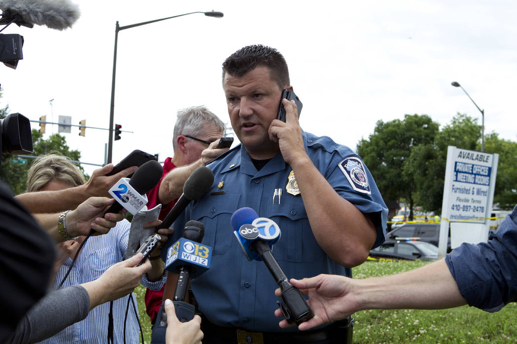 Maryland Police Lt. Ryan Frashure speaks to the media at the scene after multiple people were shot at a newspaper office building in Annapolis, Md., Thursday, June 28, 2018. (AP Photo/Jose Luis Ma ...