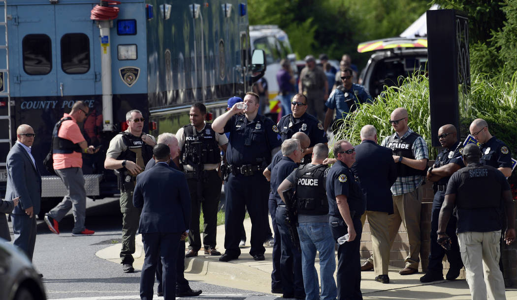 Police secure the scene of a shooting in Annapolis, Md., Thursday, June 28, 2018. A single shooter killed several people Thursday and wounded others at a newspaper in Annapolis, Maryland, and poli ...