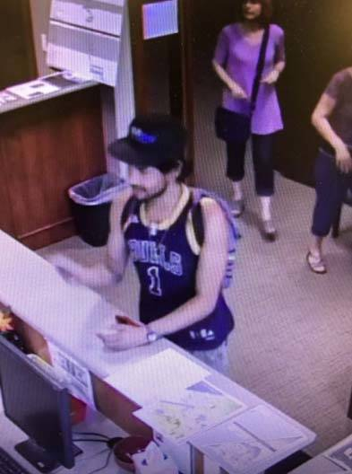 A surveillance photo released by the Iron County Sheriff's Office shows a suspect in Thursday morning's robbery at the Travel America truck stop in Parowan, Utah. (Utah County Sherif ...