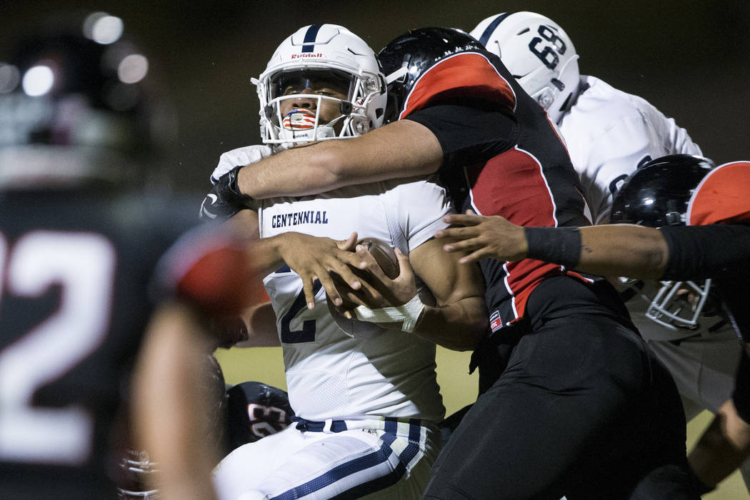 Centennial's Jamaal Evans (2) is tackled against Las Vegas defense in their football game at Las Vegas High School on Friday, Sept. 16, 2016, in Las Vegas. Las Vegas won 24-21. Erik Verduzco/Las V ...