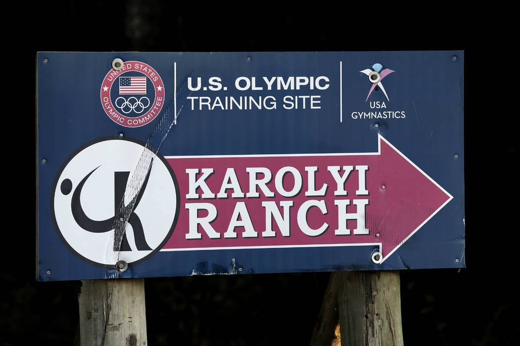 In this Sept, 12, 2015, file photo, a sign points to the Karolyi Ranch near New Waverly, Texas. The facility has since closed and Larry Nassar has been imprisoned for life. (AP Photo/David J. Phil ...