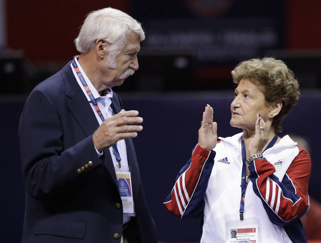 In this June 29, 2012, file photo, Bela Karolyi, left, and his wife, Martha Karolyi, talk on the arena floor before the start of the preliminary round of the women's Olympic gymnastics trials in S ...