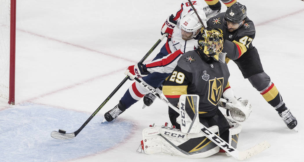 Capitals center Lars Eller (20) scores a third-period goal past Golden Knights defenseman Luca Sbisa (47) and goaltender Marc-Andre Fleury (29) during Game 5 of the NHL Stanley Cup Final on Thur ...