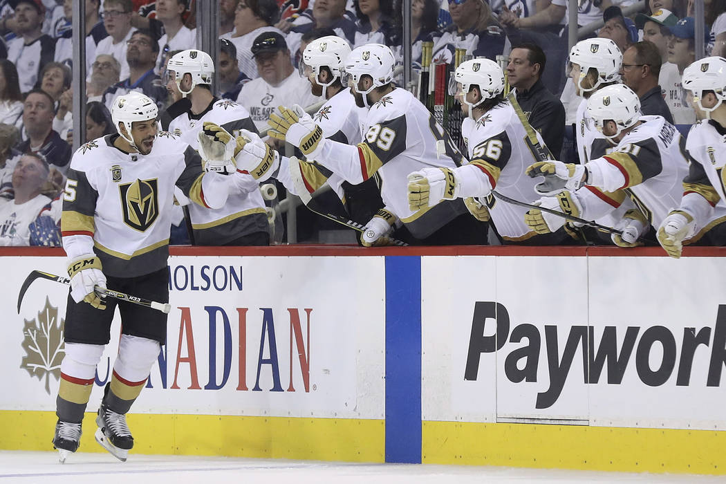The Vegas Golden Knights celebrate after Ryan Reaves (75) scored during second period NHL Western Conference Finals game 5 hockey action against the Winnipeg Jets, in Winnipeg, Sunday, May 20, 201 ...