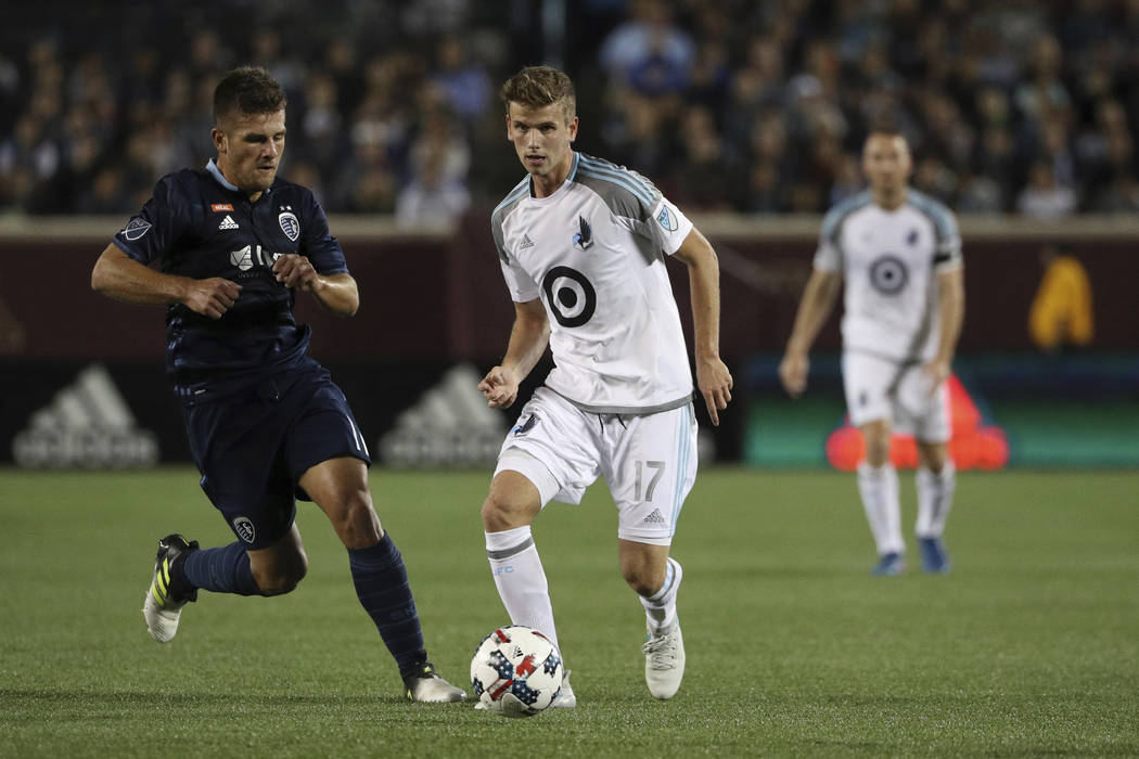In this Oct. 7, 2017 photo, Minnesota United midfielder Collin Martin (17) controls the ball as Sporting Kansas City forward Diego Rubio (11) chases during the first half of an MLS soccer game at ...