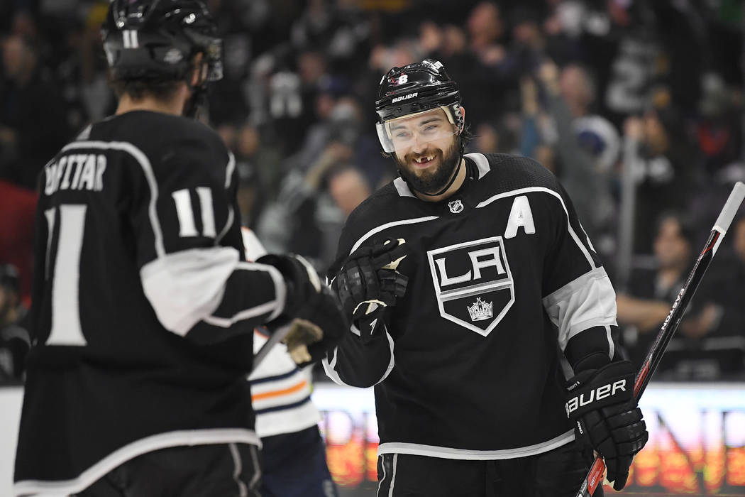 Los Angeles Kings defenseman Drew Doughty, right, congratulates center Anze Kopitar, of Slovenia, after Kopitar scored an empty-net goal during the third period of an NHL hockey game against the E ...