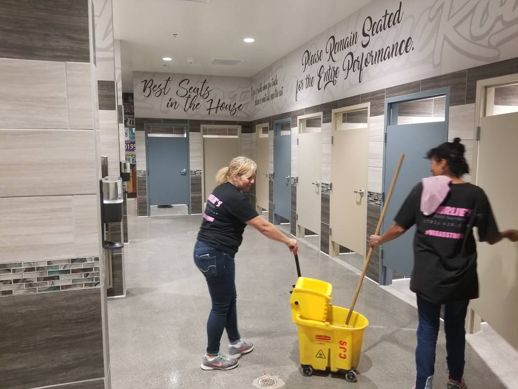 Workers clean bathroom floors at Terrible's Road House in Jean, Nev., June 29, 2018. Terrible's Road House's will have 60 restrooms, or 4,000 square feet of bathroom space. All sinks and soap disp ...