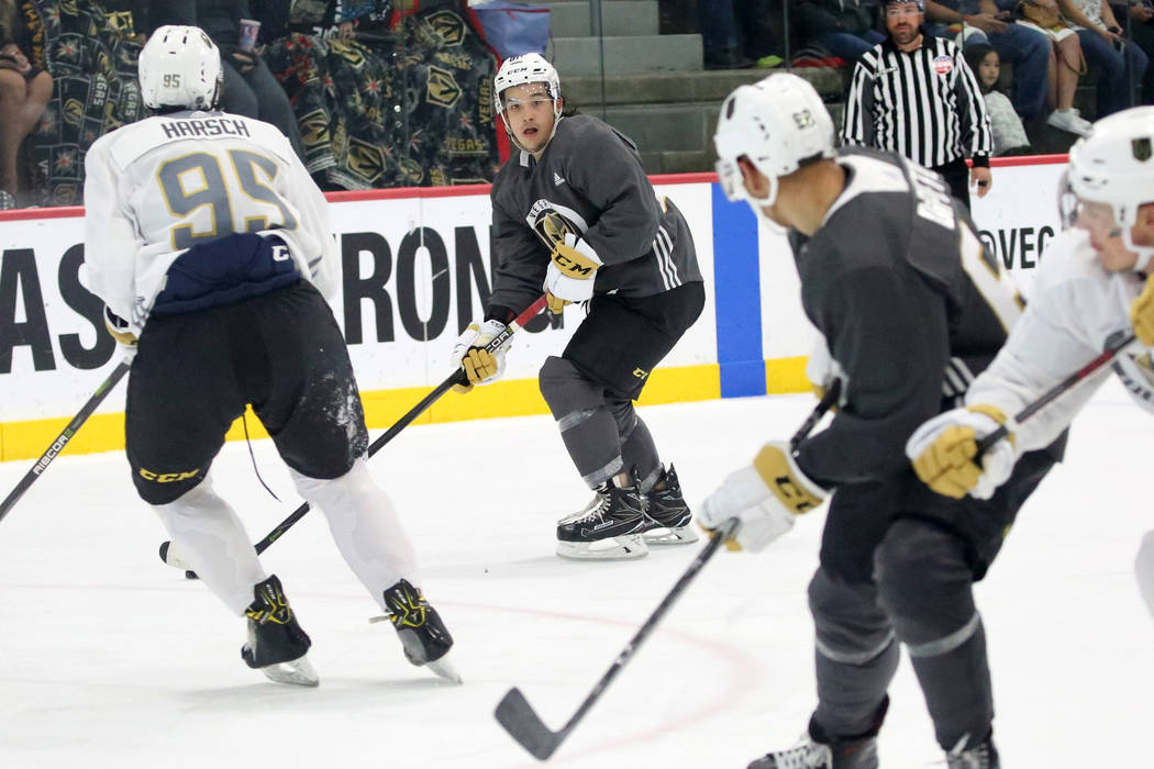 Vegas Golden Knights prospect Tyler Wong, center, looks for an opening during a scrimmage game at Golden Knights development camp at City Center Arena on Friday, June 29, 2018, in Las Vegas. Bizua ...