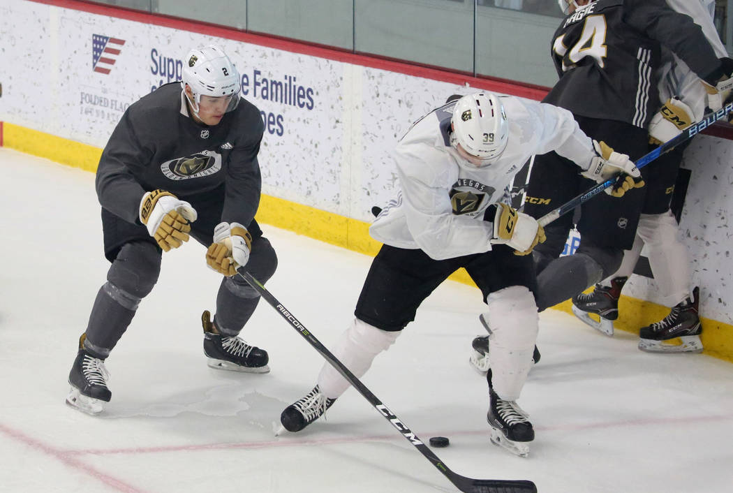 Vegas Golden Knights prospect Zach Whitecloud, left, chases Jake Leschyshyn during a scrimmage game at Golden Knights development camp at City Center Arena on Friday, June 29, 2018, in Las Vegas. ...