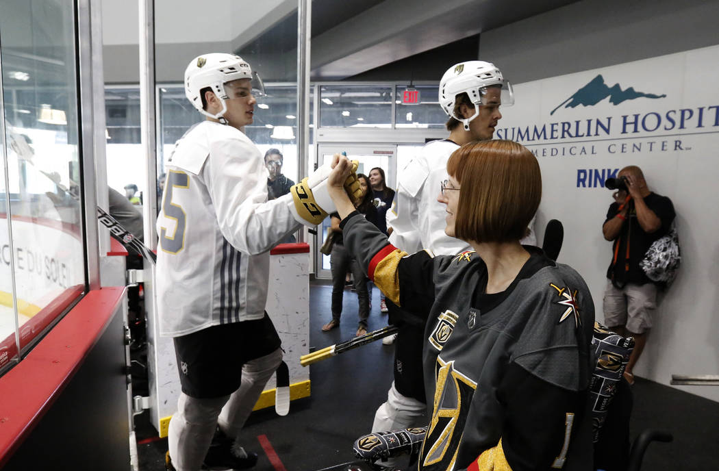 Vegas Golden Knights prospect Wyatt Ege makes a fist bump Shannon Walker of Las Vegas after a scrimmage game at Golden Knights development camp at City Center Arena on Friday, June 29, 2018, in La ...