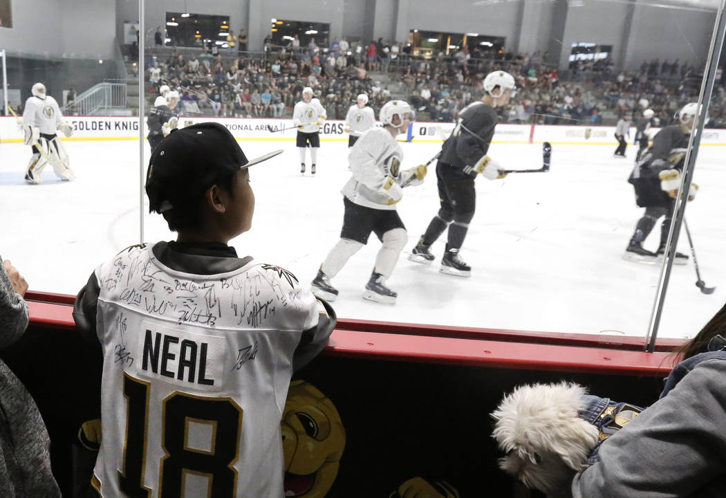 Joe Yokomori, 2, of Las Vegas watches as Vegas Golden Knights prospects play a scrimmage game at Golden Knights development camp at City Center Arena on Friday, June 29, 2018, in Las Vegas. Bizuay ...