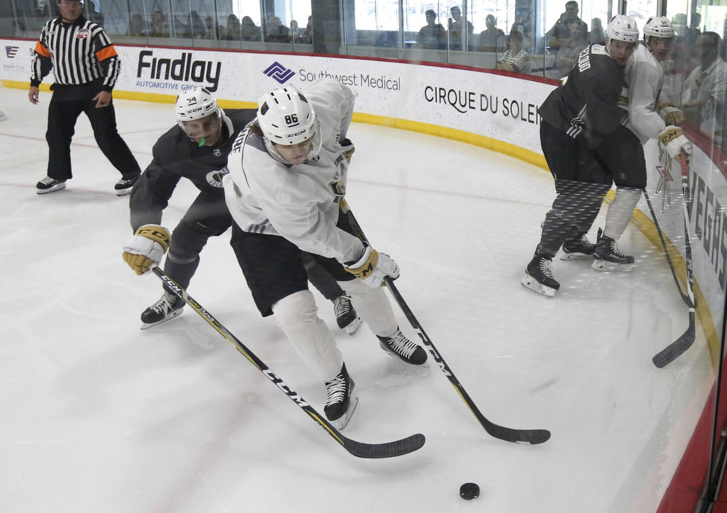 Vegas Golden Knights prospects Jake Slaker, left, and Steve Owre fight for the puck during a scrimmage game at Golden Knights development camp at City Center Arena on Friday, June 29, 2018, in Las ...