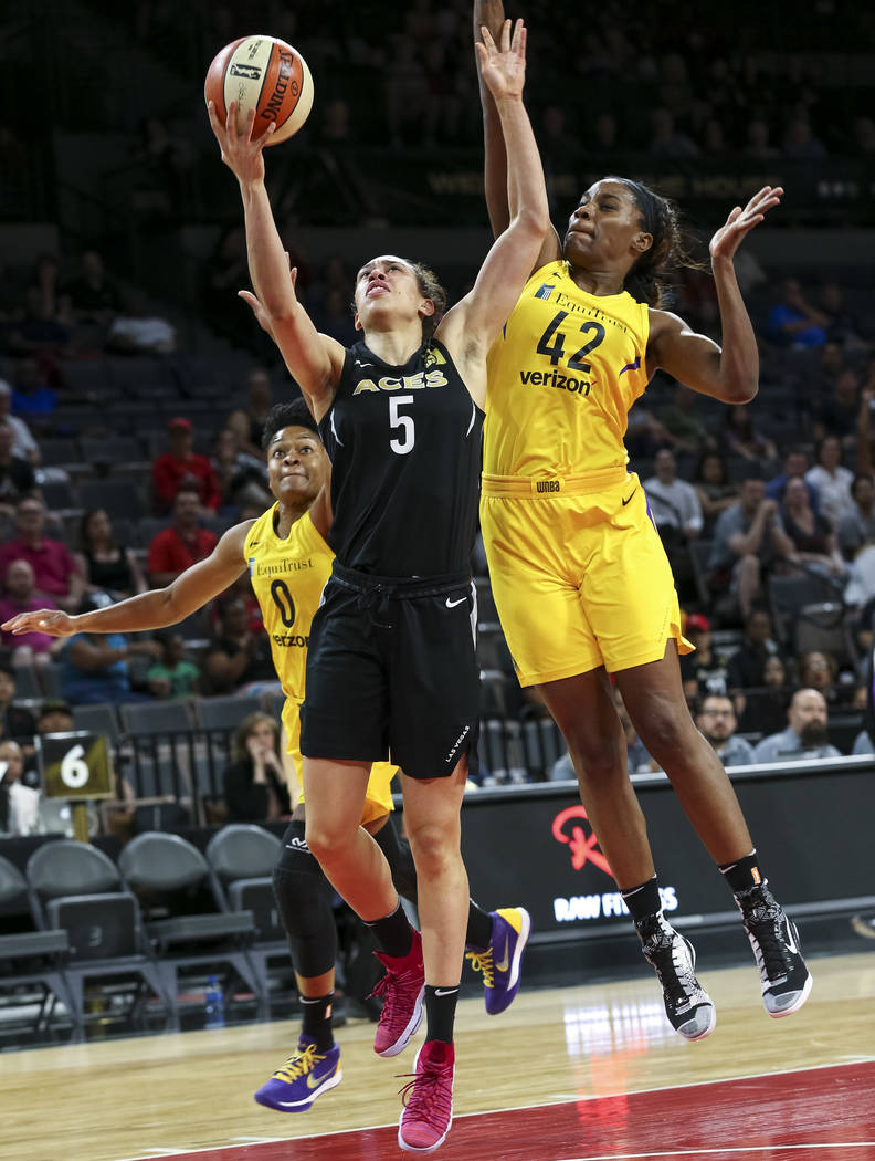 Las Vegas Aces forward Dearica Hamby (5) attempts a shot against Los Angeles Sparks center Jantel Lavender (42) during the first half of a WNBA basketball game at the Mandalay Bay Events Center in ...