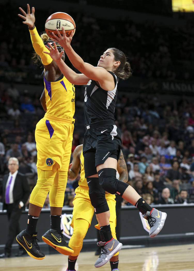 Las Vegas Aces guard Kelsey Plum (10) shoots over Los Angeles Sparks forward Essence Carson (17) during the first half of a WNBA basketball game at the Mandalay Bay Events Center in Las Vegas on F ...