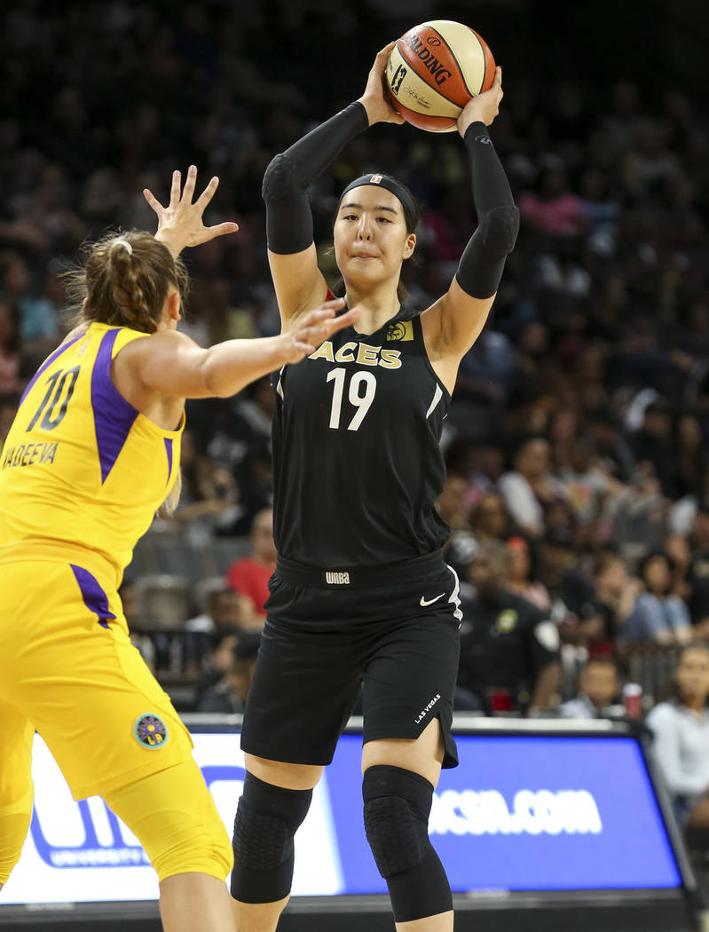 Las Vegas Aces center Ji-Su Park (19) looks to pass against Los Angeles Sparks center Maria Vadeeva (10) during the first half of a WNBA basketball game at the Mandalay Bay Events Center in Las Ve ...