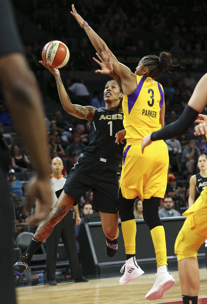 Las Vegas Aces forward Tamera Young (1) takes a shot against Los Angeles Sparks forward Candace Parker (3) during the first half of a WNBA basketball game at the Mandalay Bay Events Center in Las ...