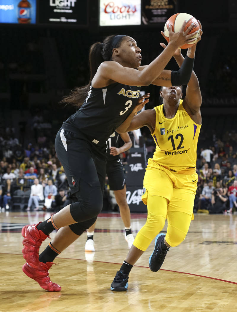 Las Vegas Aces center Kelsey Bone (3) pulls in a loose ball over Los Angeles Sparks guard Chelsea Gray (12) during the first half of a WNBA basketball game at the Mandalay Bay Events Center in Las ...
