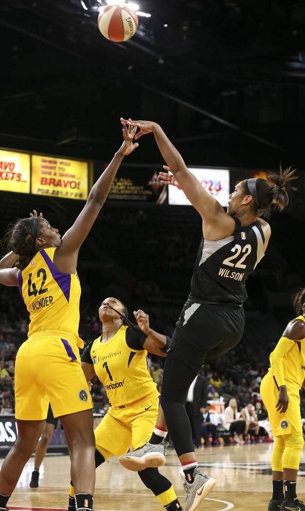 Las Vegas Aces center A'ja Wilson (22) with the fade away shot over Los Angeles Sparks center Jantel Lavender during the first half of a WNBA basketball game at the Mandalay Bay Events Center in L ...